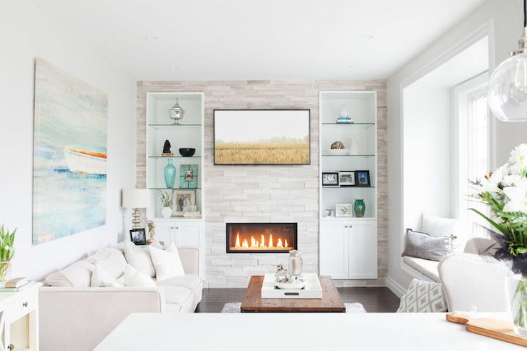 Contemporary living room features a fireplace wall fitted with ...