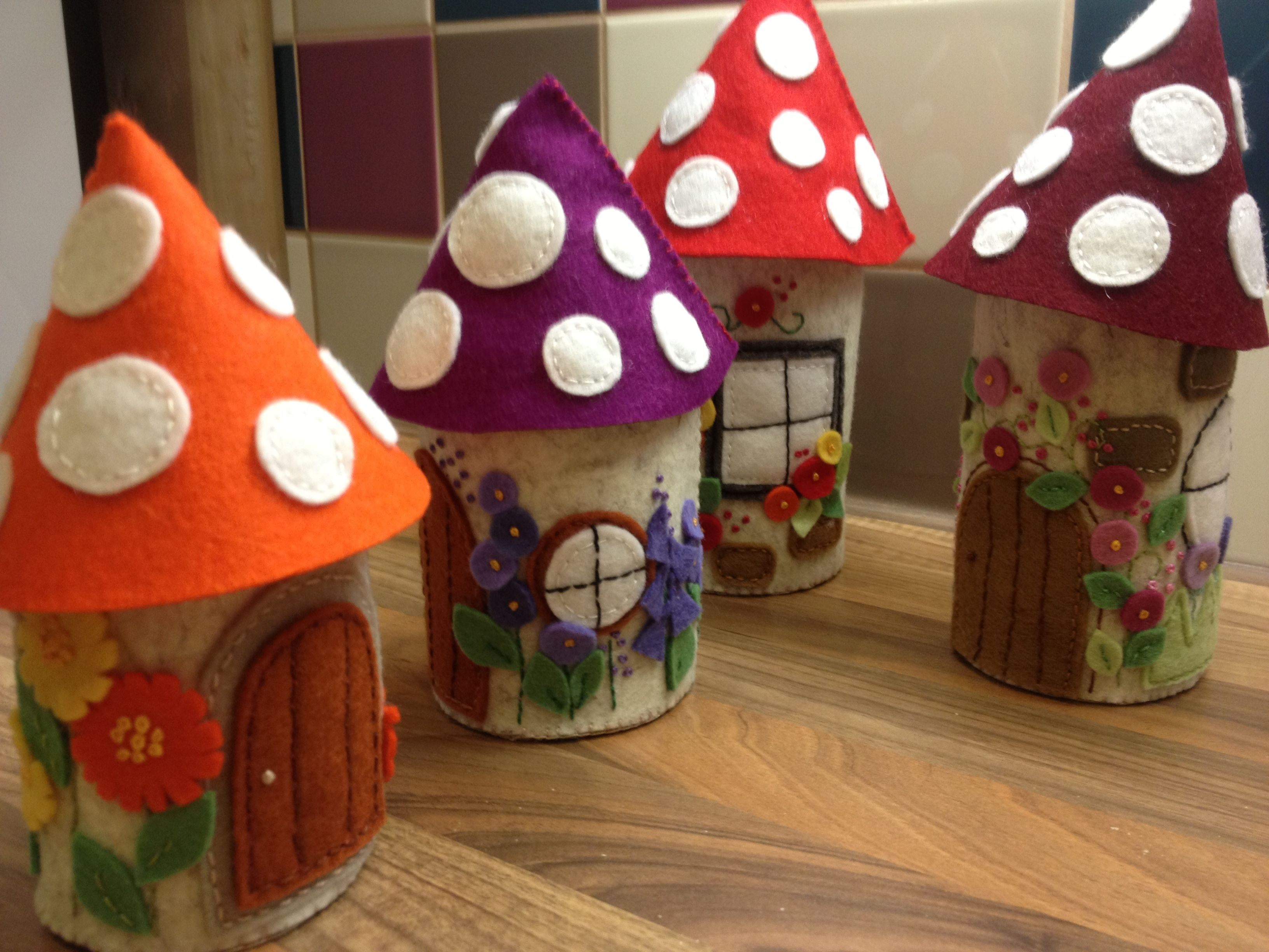 A little village of hand embroidered felt pixie houses in 100% wool felt