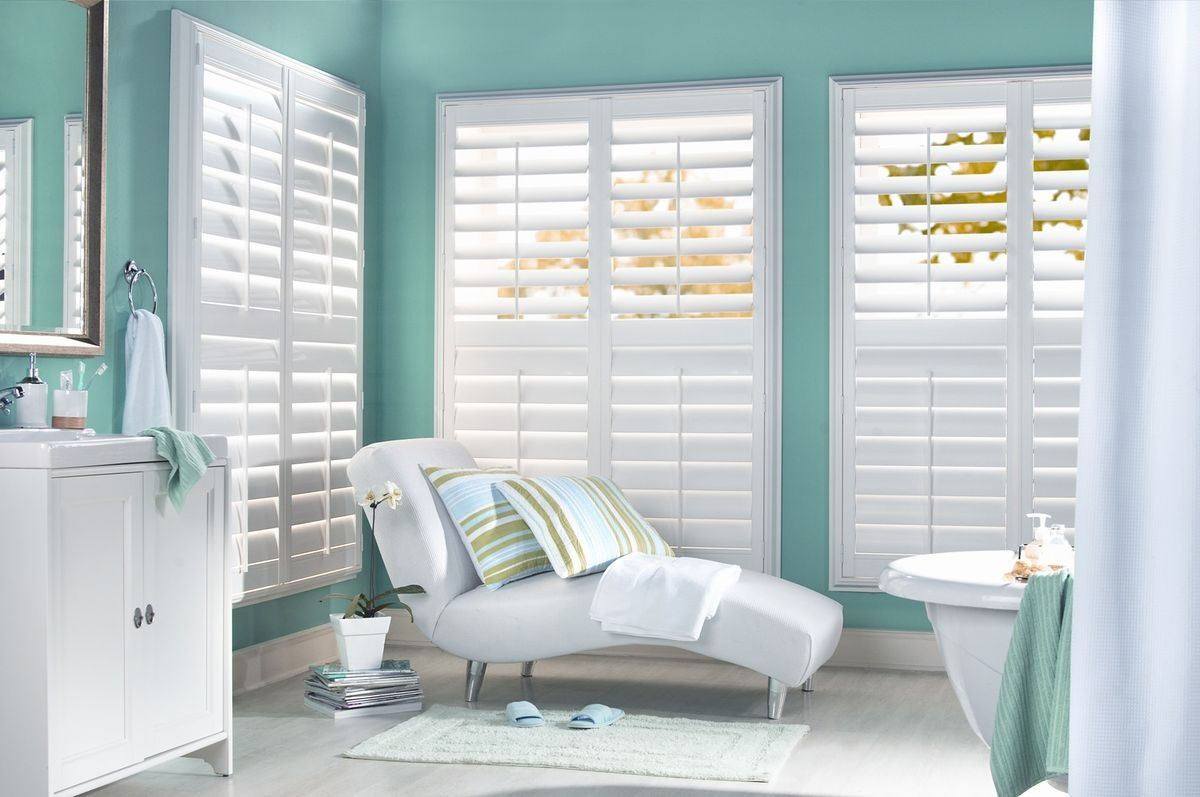 white plantation shutters, wide louver slats. bathroom window