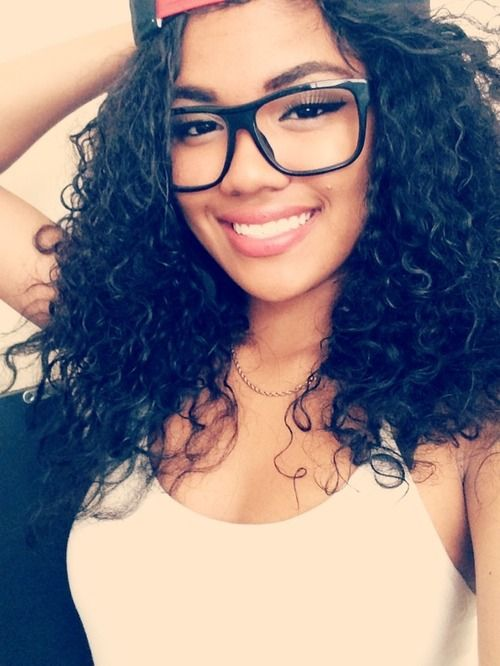 Girl With A Beautiful Smile Curly Hair And Spectacles