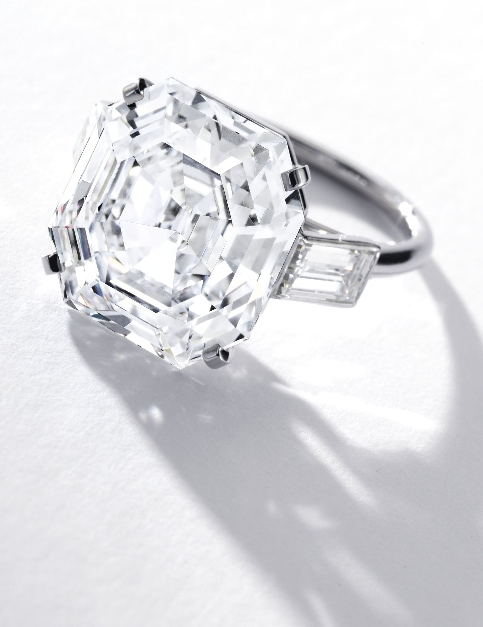 Very Fine Diamond Ring Cartier Set With A 13 60 Carat Cut Cornered Rectangular Step Cut Diamond Flanked By Two Baguette Diamonds Mounted In Platinum