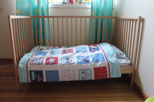 Sniglar Ikea crib with one side removed, turned into a toddler's bed