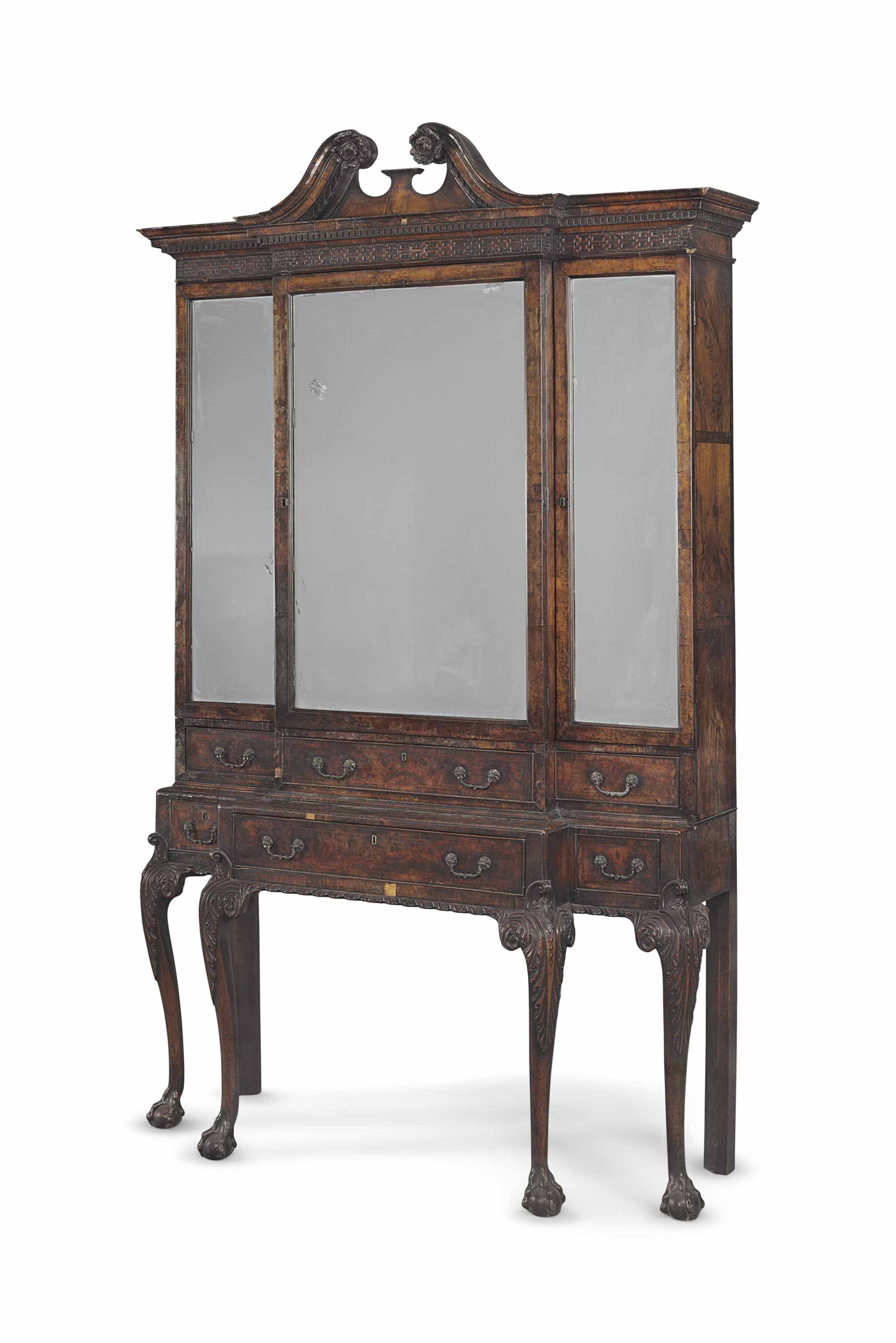 date unspecified A GEORGE II WALNUT CABINET ON STAND IN THE MANNER
