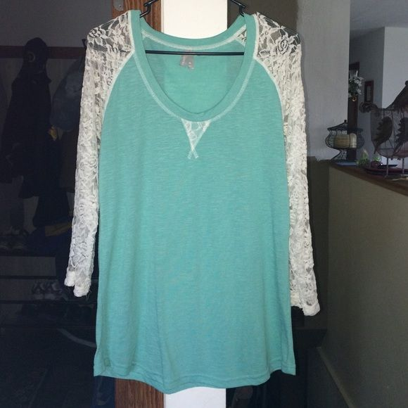 Vanity long sleeve lace top It has been lightly worn, only wore it a few times so it's in great shape! This cute turquoise blue shirt is great to wear with a pair of jeans paired with a scarf. It also looks great without a scarf and when I wore it I rolled the sleeves halfway. Vanity Tops Blouses
