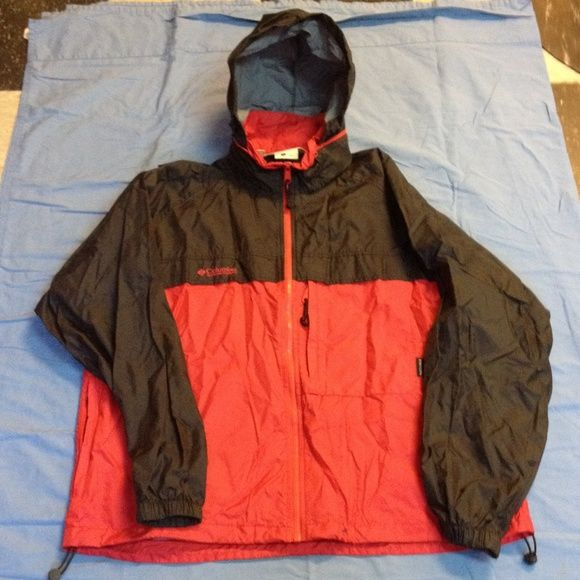 Columbia pack able rain jacket Red and black Columbia rain jacket. Has a small stain on bottom, see last photo. Columbia Jackets & Coats