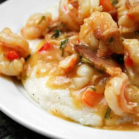 There's nothing like shrimp cooked in a gravy of bacon, onion, bell pepper and scallions and spooned onto a mound of peppery cheese grits. #shrimpandgrits