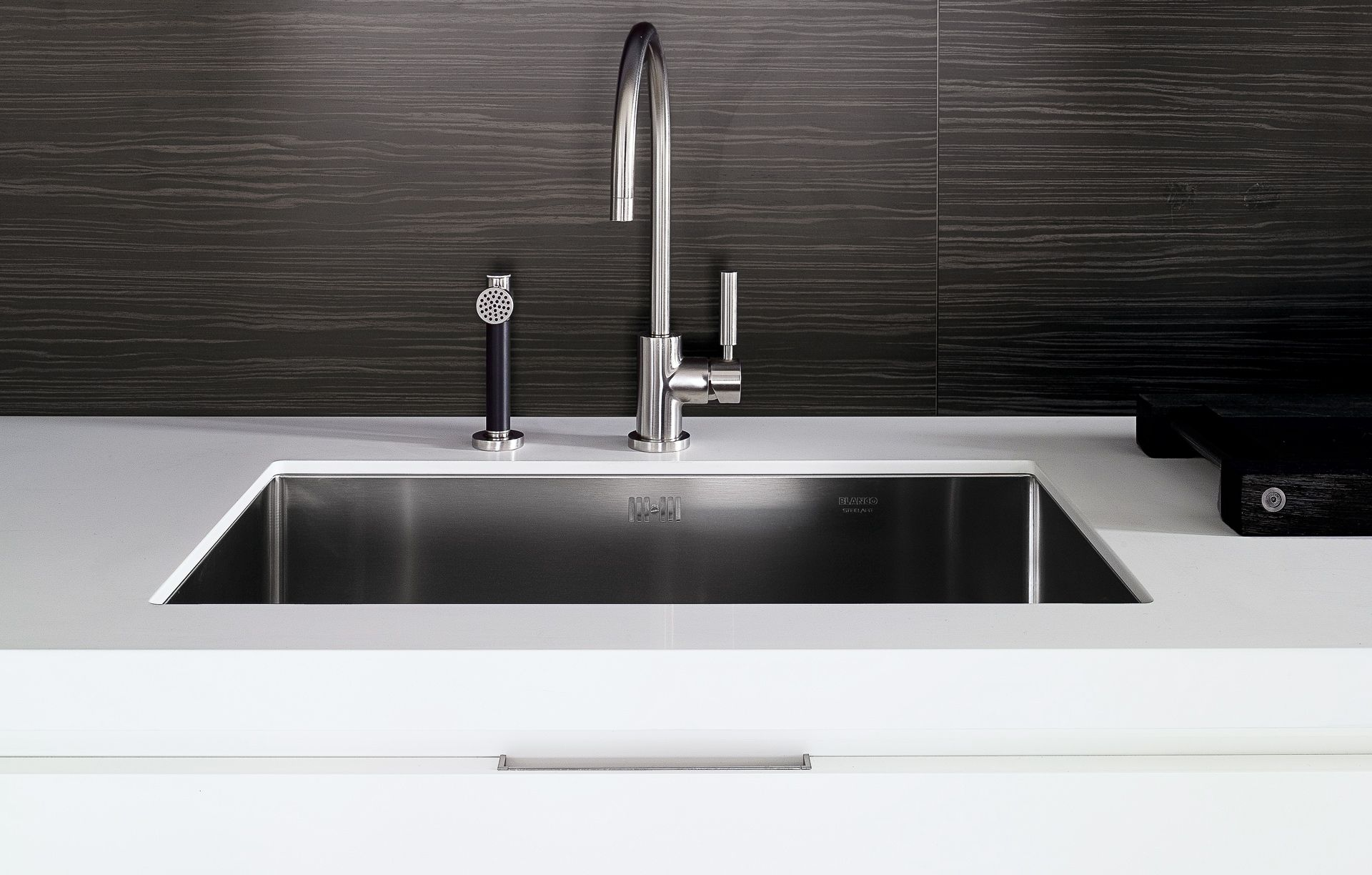 Stainless steel faucet sink on white quartz countertop   Kitchen in ...