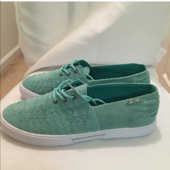 Mint Candy Apple Groove sneakers! Cute and Unique Brand New Groove sneakers. Pastel teal color. Shoe is lace up. White sole. Wear these funky sneakers with jeans or leggings or shorts. Multifaceted sneaker. Material is like a faux suede. Back of the shoe says Groove. Interior is a fun cloth floral print. Groove Shoes Sneakers