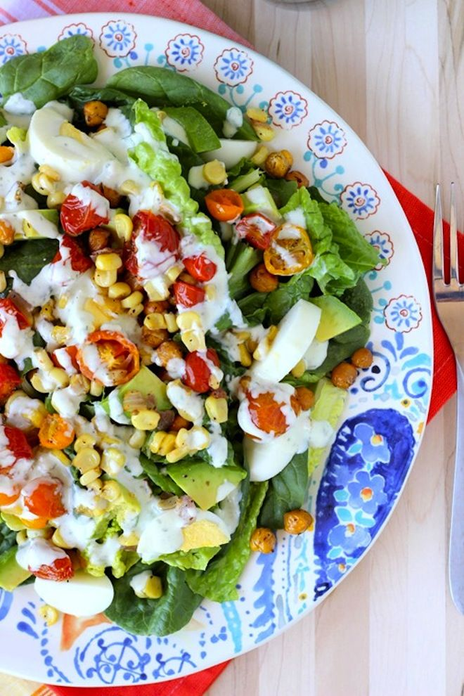 This refreshing roasted corn tomato salad is perfect is the perfect lunch on a sunny, summer day.