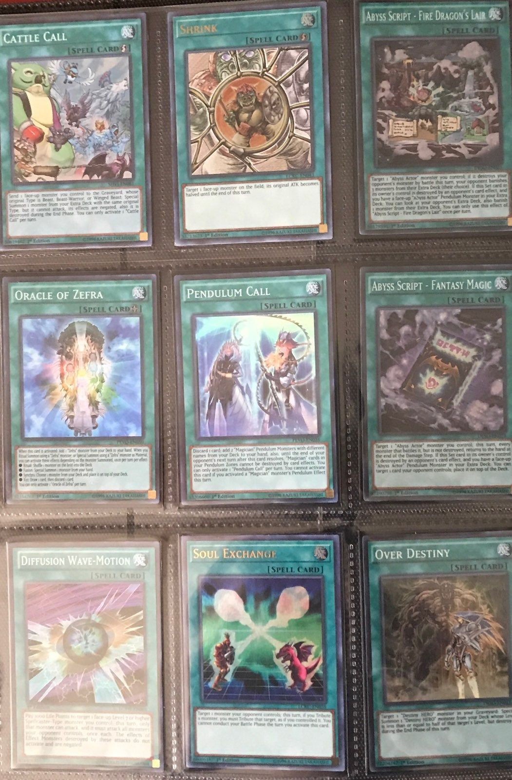 Im selling yugioh spell cards near mint to gem mint 9