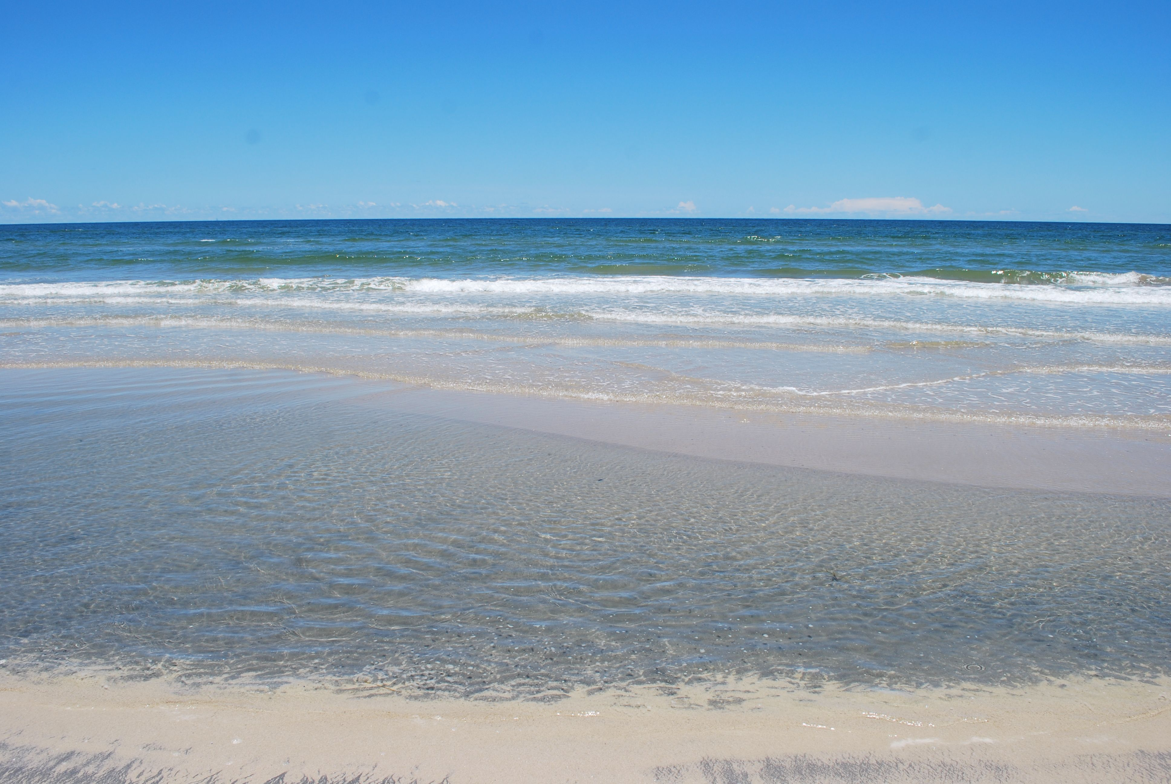 Crystal Clear Water Calm Surf And Azure Skies At Malaquite Beach Padre Island