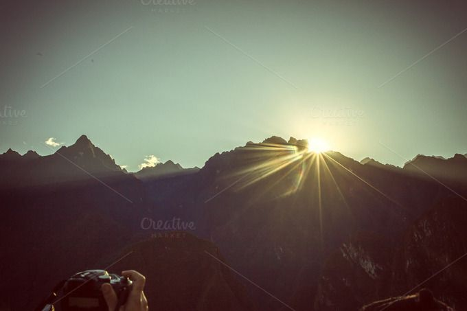 Check out Taking a photo of the sunrise by Patricia Hofmeester on Creative Market