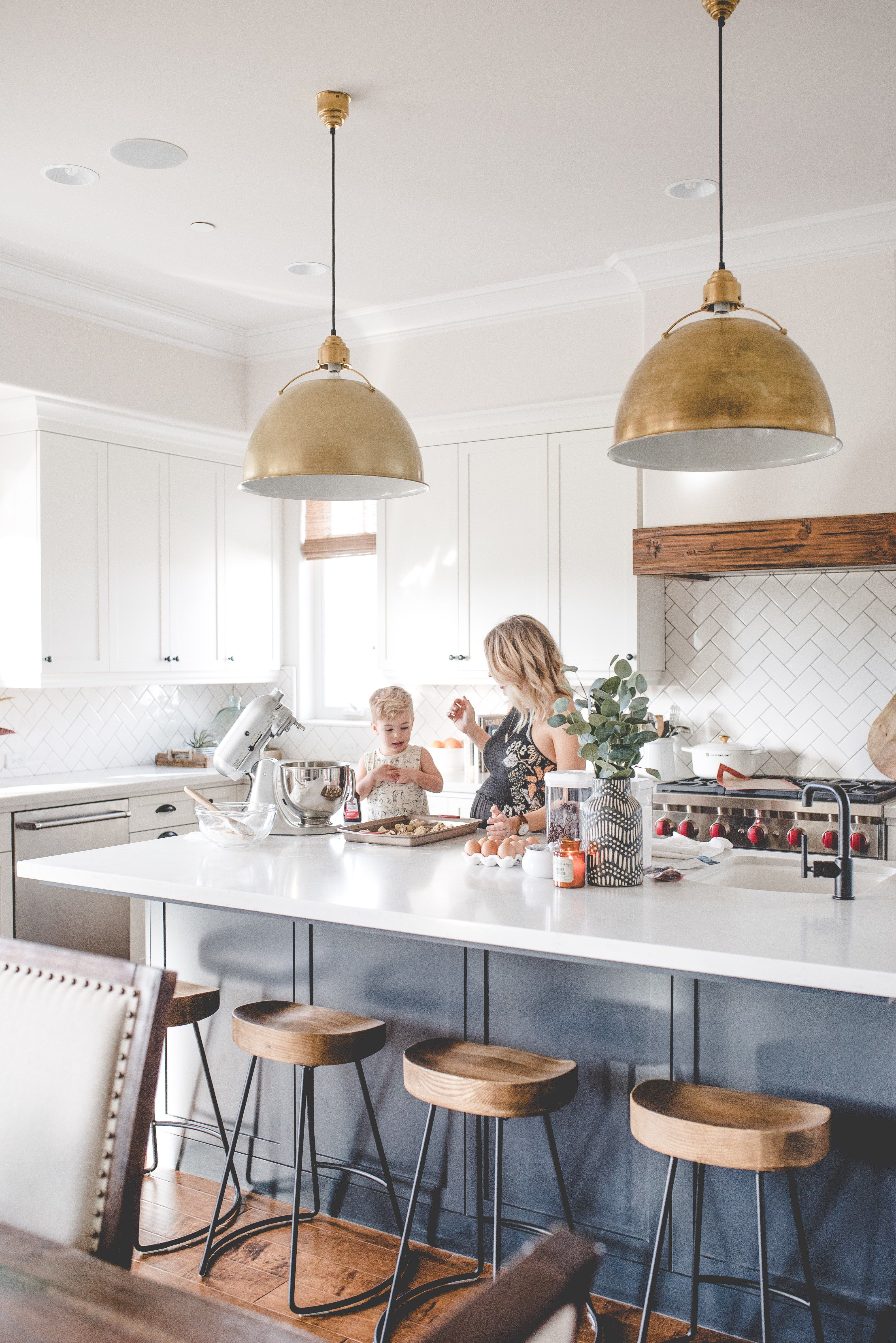 kaila walls, kitchen, blue island, white kitchen, gold pendants ...