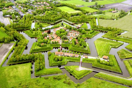Fort Bourtange  A star fort located in Netherlands. It was built in 1593 with the purpose to control the only road between Germany and the city of Groningen, which was controlled by the Spaniards