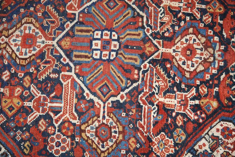 Selection of decorative and antique handmade tribal rugs from various parts of the world.