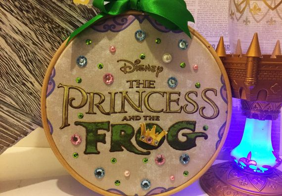 This is an Embroidery Hoop Art inspired by Disneys Princess and the Frog.  The Hoop is 7 inch  The Hoop is decorated with gems and hand stitched sequins.