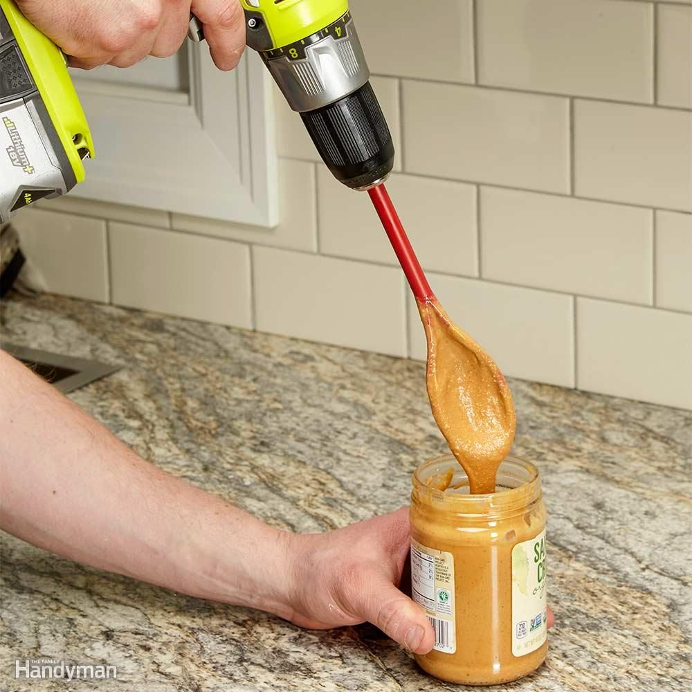 Cordless Kitchen Drill Mixer - Sometimes we find it tough to mix stuff in a small jar by hand. Like old-fashioned oily peanut butter, for instance. It's not uncommon for us to reach for a power tool to solve a problem, so out to the garage we went. As it turns out, the handle of a mixing spoon fits perfectly in the chuck of our cordless drill!
