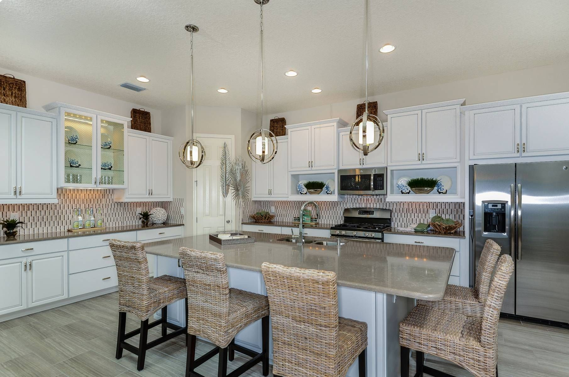 White Cabinets Enhance The Gourmet Kitchen In Our Longboat Model In Lakeshore Ranch Tampa Real Estate New Homes Beautiful Kitchens Cabinets To Go New Homes