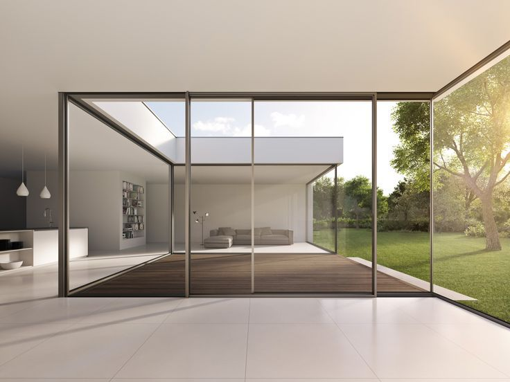 Room-high glazing with single elements up to 4 meters wide and 6 meters high.