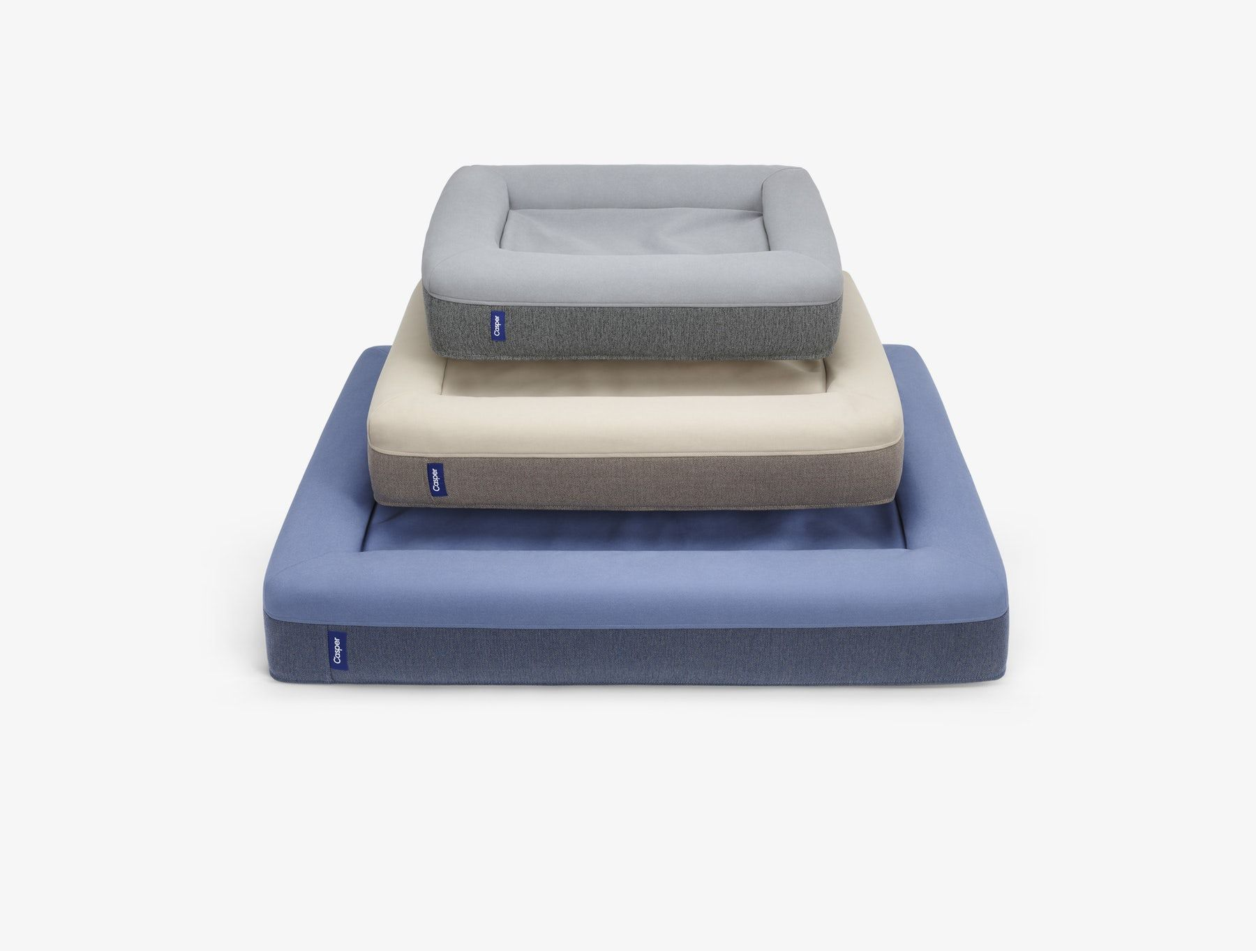 three sizes of the casper dog mattress stacked on top of each other