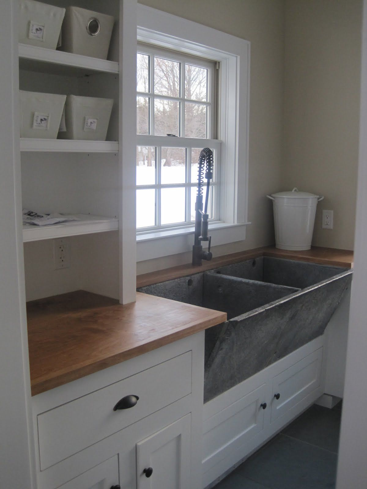 I love the old concrete or stone utility sink it could be a bit shallower or not divided i like the feel of using an rustic element with finished