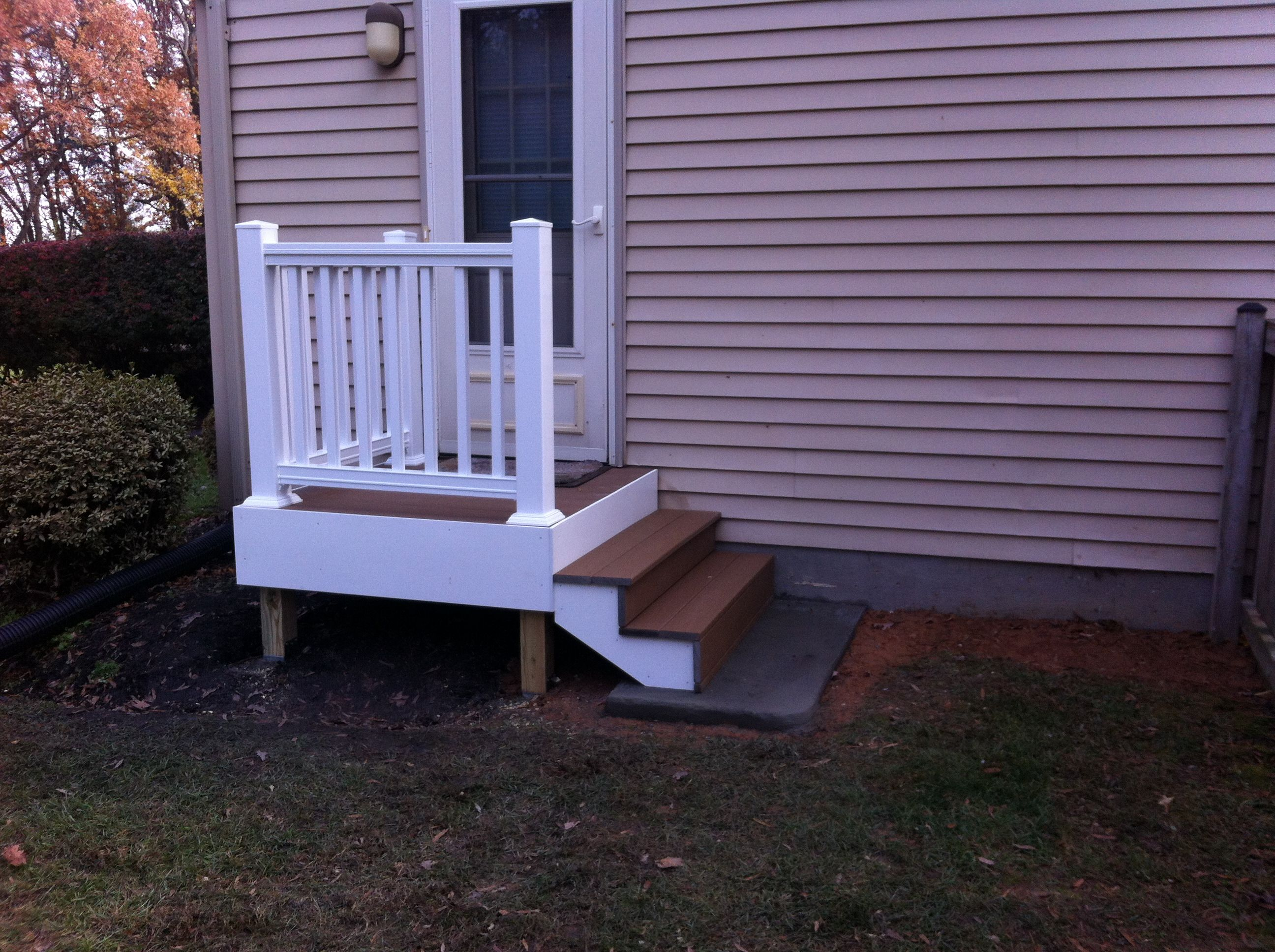 Back door steps with landing composite decking and for White back door