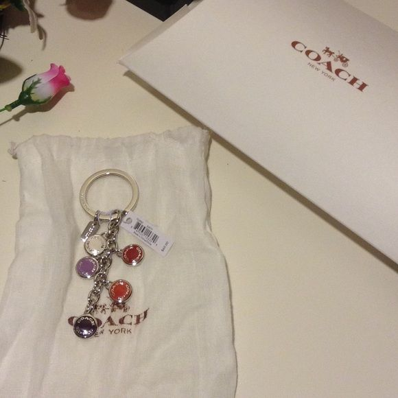 NWT Coach Buttons Multi Mix Keychain Brand: Coach Model: F63982 Condition: New with Tags Size: One Size  NEW WITH TAG COACH BUTTONS MULTI MIX KEY RING KEYCHAIN   COACH STYLE # F63982   Plated metal   1 1/4 attached split key ring Coach Accessories Key & Card Holders