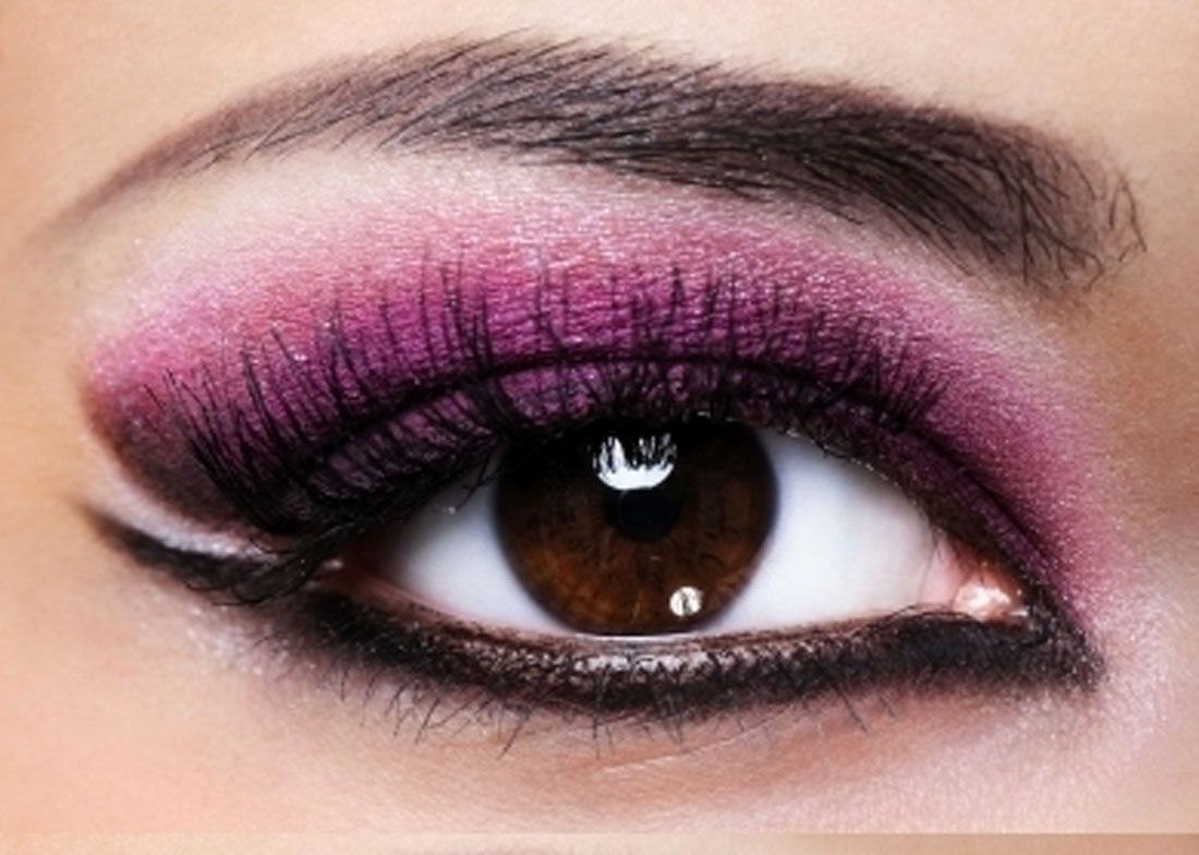 Makeup with bright purple eyeliner