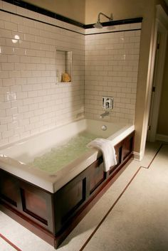 Subway Tile And Wood Encasing The Tub Awesome 1909 Whole House Remodel Bathroom