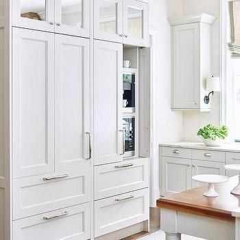 coffee maker and microwave hidden behind cabinets | 1000