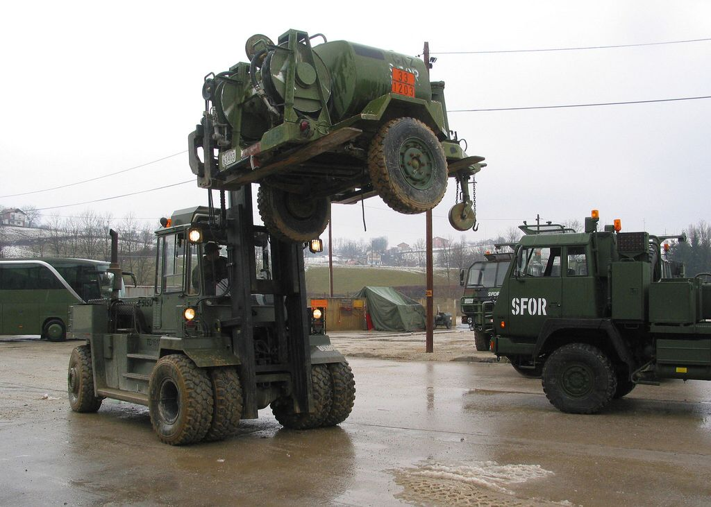Fuel trailer, Ruff Terrain Forklift (RFTL), and HLVW, used