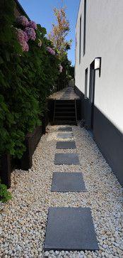 That narrow path has potential too...   Backyard ...