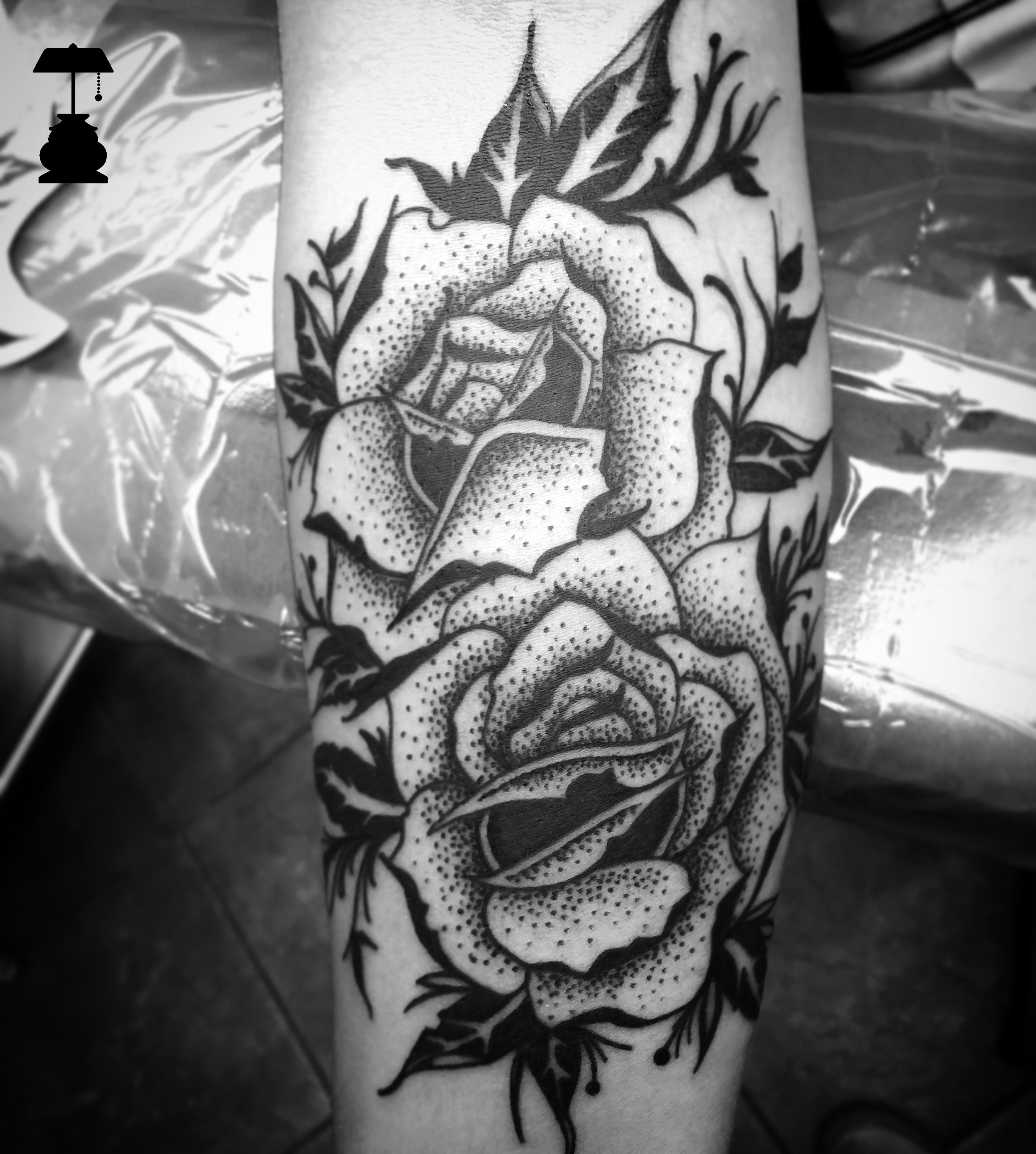 Blackwork roses forearm tattoo with stippling by artist