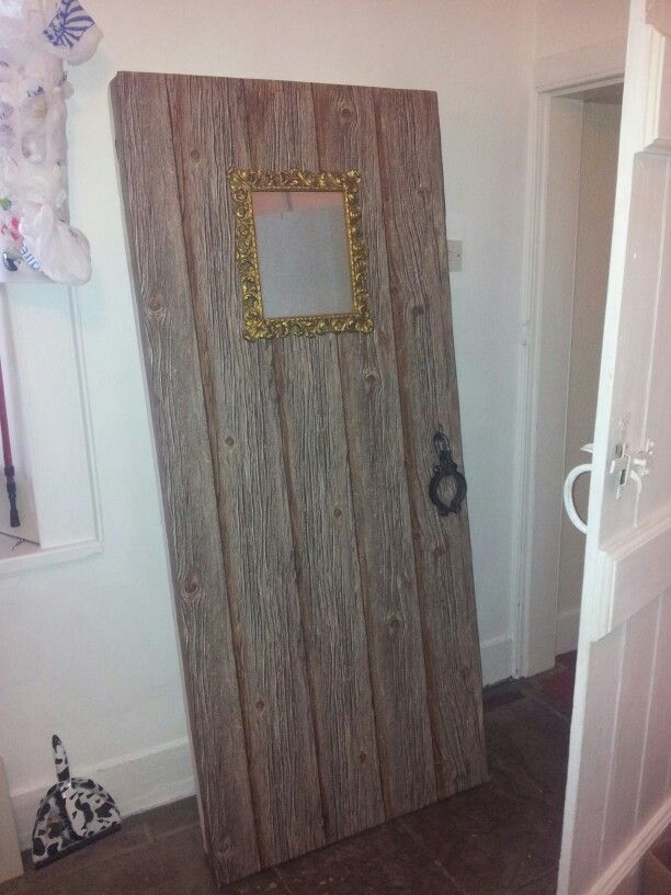 Polystyrene door with wood effect wallpaper and two way mirror finished