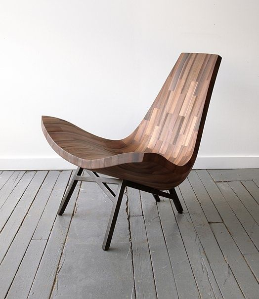 """""""Water Tower"""" chair, a comfy undulating lounger made from reclaimed timber sourced from a certified authentic New York City water tower."""