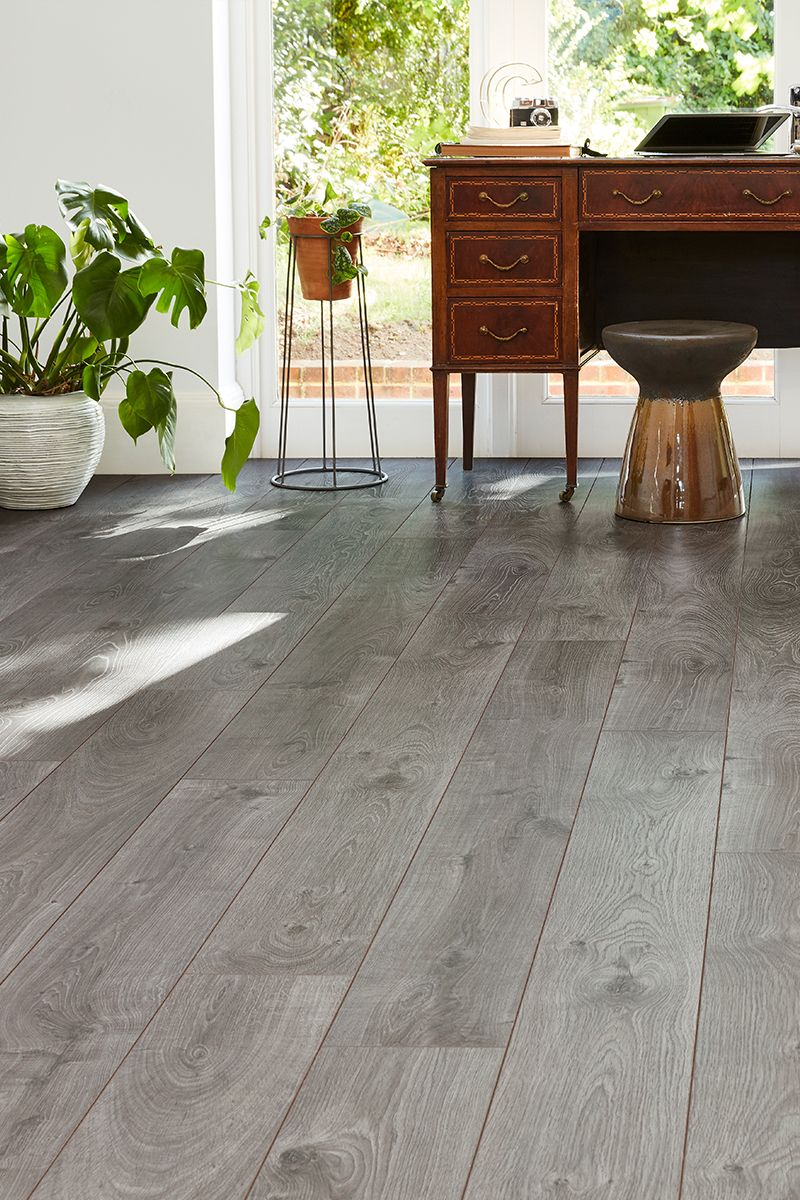Available In Longer Boards That Work Best In Large Rooms And Open Floor Plans Vantage Wood 12mm L Grey Laminate Flooring Living Room Flooring Grey Wood Floors