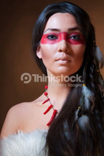 American Indian With Paint Face Camouflage Studio Photo With