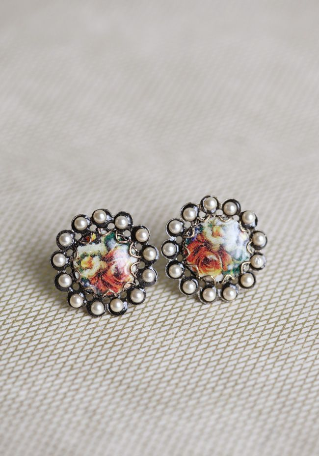 """Princess Pearl Indie Earrings 24.99 at shopruche.com. Glowing faux pearls encircle a floral bead on these intricate brass studs.1"""" wide"""