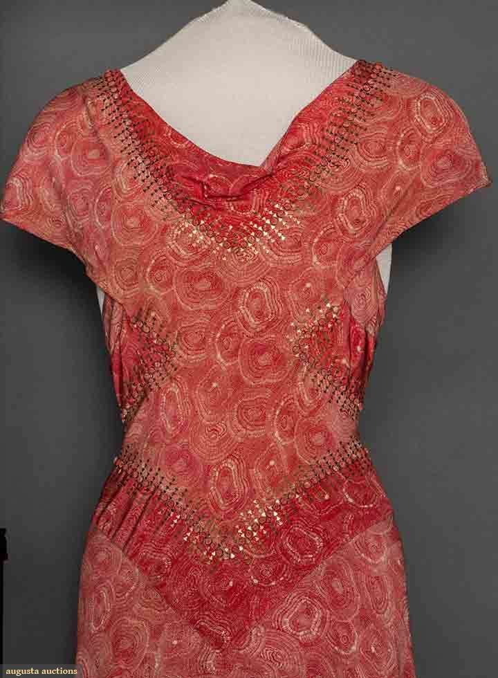POPPY PRINT EVENING DRESS, 1930s. Bias cut, cowl neckline, cap sleeve, V shaped bodice & midriff panels of darker red outlined w/ tiny buttons & gold metallic trim. Detail