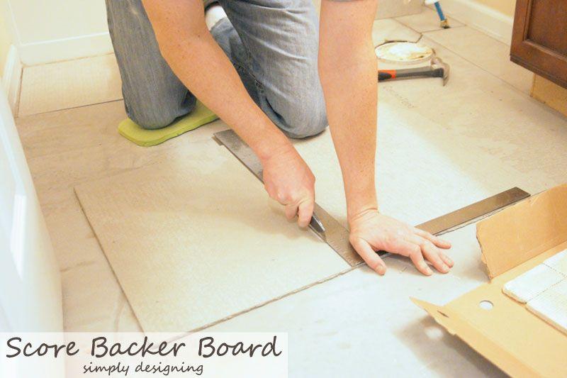 How to score concrete backer board for tile floor