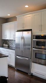 I love the white cabinets with dark wood floors and dark counters - Modern Craftsman Kitchen