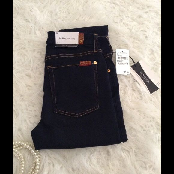 """7 FAMK JEANS super skinny Awesome jeans nice dark sophisticated color that can be worn day or dress up for night out  new with all tags SUPER SKINNY SLIM ILLUSION SECOND SKIN LEGGING LIKE APPEAL WITH MAXIMUM STRETCH & retention for incredible shape. Inseam: 30 """" long 7 for all Mankind Jeans Skinny"""