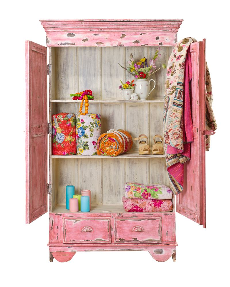 This pink distressed cabinet would be the perfect focal point in a little girl's bedroom.