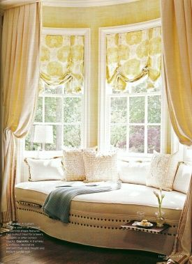 Window Seat Curtains a deep bow window with soft roman shades and drapery panels to
