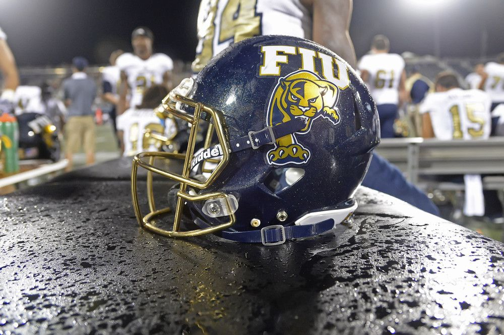 September An FIU Helmet Sits On A Wet Training Table Late - Lewis training table