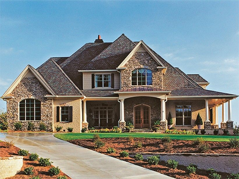 a beautiful wrap around porch welcomes you to this great stone and