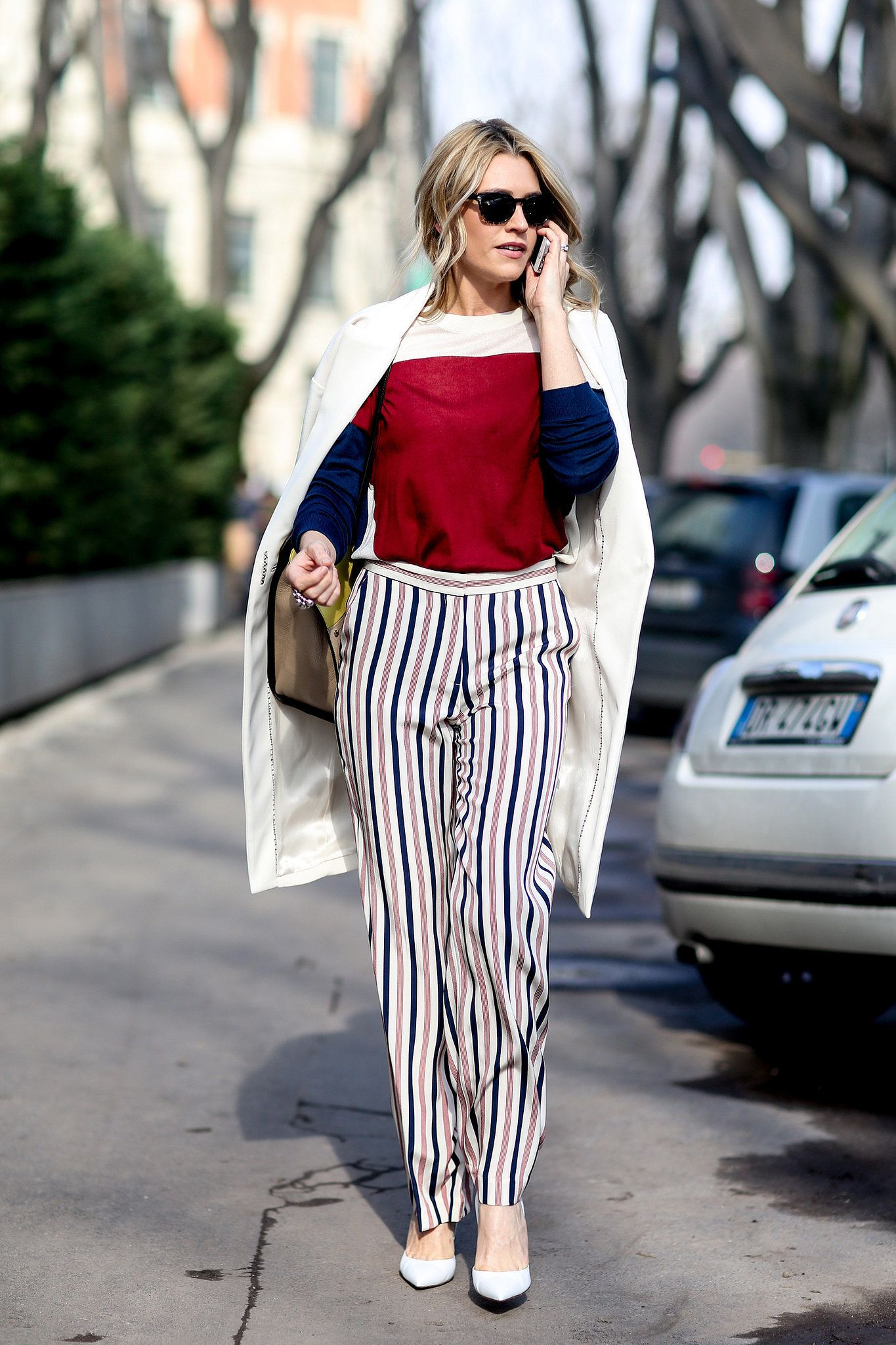 Mixing stripes and colorblocking with ease. #Streetstyle #MFW Fall 2014