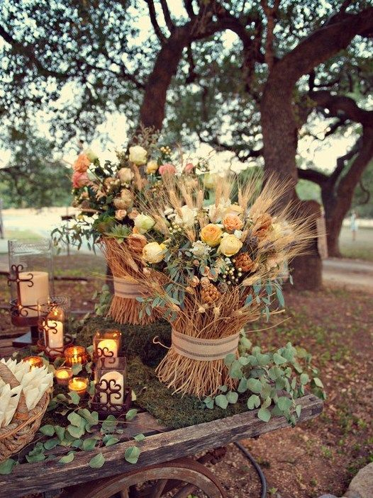 Stick bundles as flower containers.  This is a great idea for a fall wedding