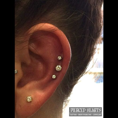 Triple helix by APP member Chuck Elliott - Neometal prong CZ's. Piercings done at Pierced Hearts Tattoo Parlor in Seattle.