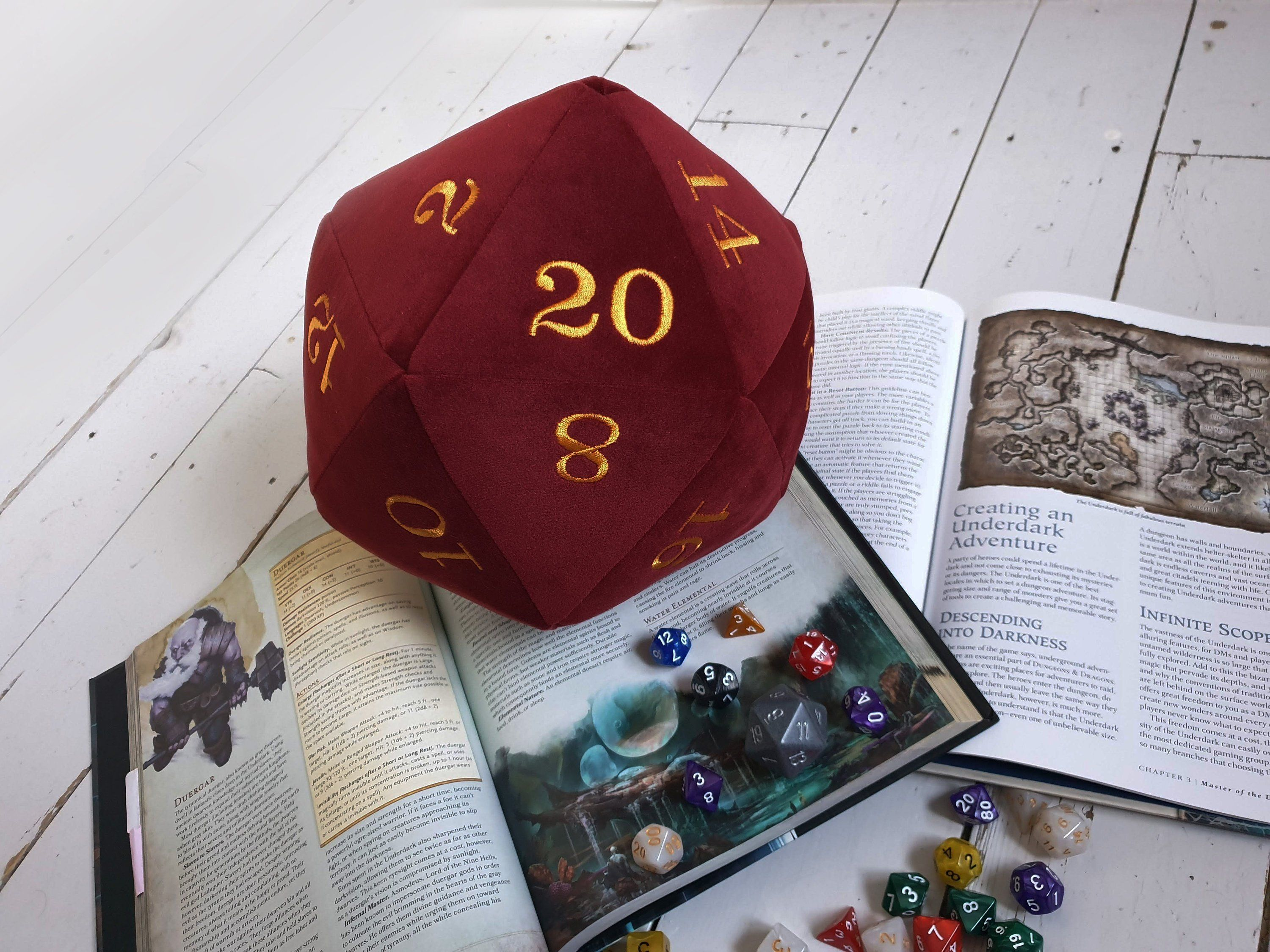 Huge Velvet D20 Plush Dice. Deluxe giant dice in a deep red velvet fabric and machine embroidered with rich yellow coloured numbers.